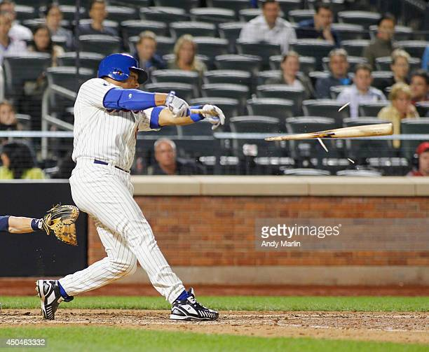 Bobby Abreu of the New York Mets breaks his bat in the ninth inning against the Milwaukee Brewers during the game at Citi Field on June 11 2014 in...