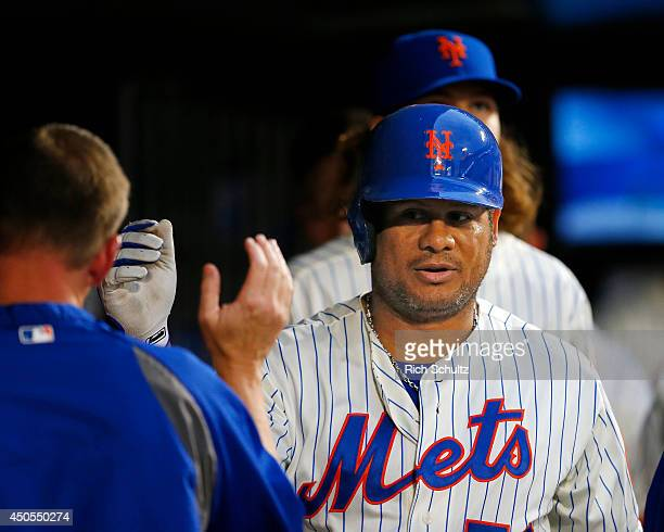 Bobby Abreu of the New York Mets is congratulated by teammates after hitting a sacrifice fly that scored Daniel Murphy during the fourth inning...