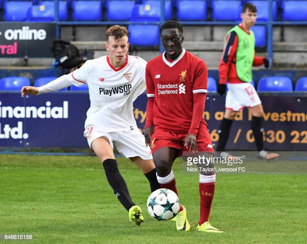 Bobby Adekanye of Liverpool and Javier Vazquez Lopez of Sevilla in action during the UEFA Champions League group E match between Liverpool FC and...