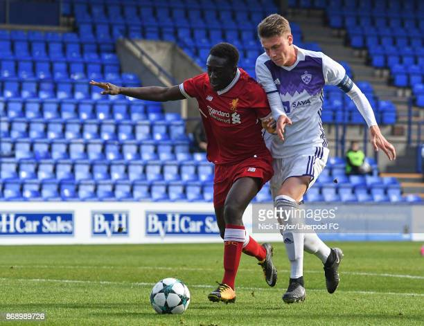 Bobby Adekanye of Liverpool and Koblar Luka of NK Maribor in action during the Liverpool v Maribor UEFA Youth League game at Prenton Park on November...