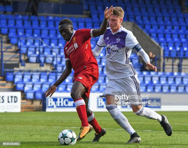 Bobby Adekanye of Liverpool and Koblar Luka of NK Maribor in action during the Liverpool and Maribor UEFA Youth League game at Prenton Park on...