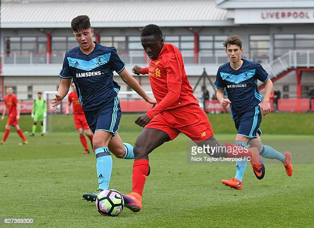 Bobby Adekanye of Liverpool and Nathan Guru and Liam Cook of Middlesbrough in action during the Liverpool v Middlesbrough U18 Premier League game on...