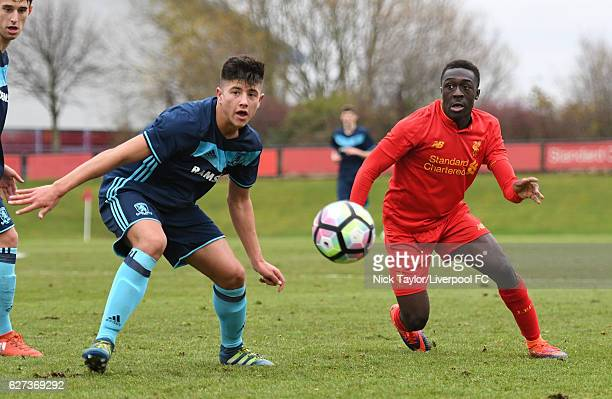 Bobby Adekanye of Liverpool and Nathan Guru of Middlesbrough in action during the Liverpool v Middlesbrough U18 Premier League game on December 3...
