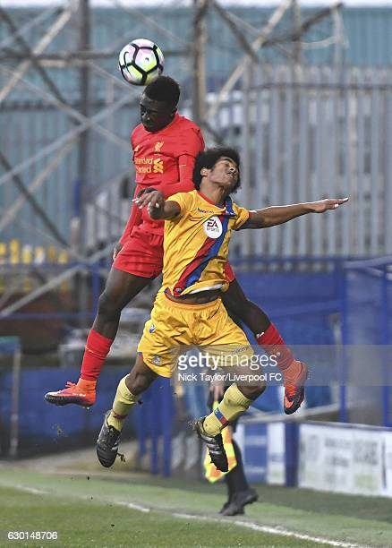 Bobby Adekanye of Liverpool and Tariq Ossai of Crystal Palace in action during the FA Youth Cup 3rd Round game at Prenton Park on December 17 2016 in...