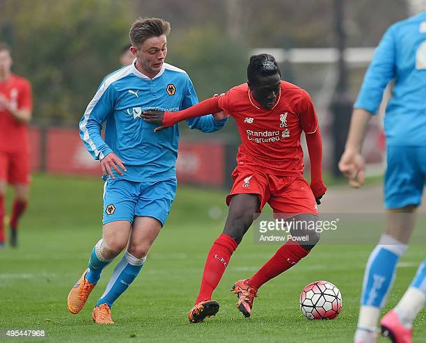 Bobby Adekanye of Liverpool competes with Christian Herc of Wolverhampton Wanderers during the Barclays U18 Premier League match between Liverpool...