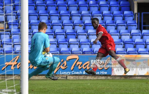 Bobby Adekanye of Liverpool sees his shot saved by Cajnko Tibor of NK Maribor during the Liverpool v Maribor UEFA Youth League game at Prenton Park...