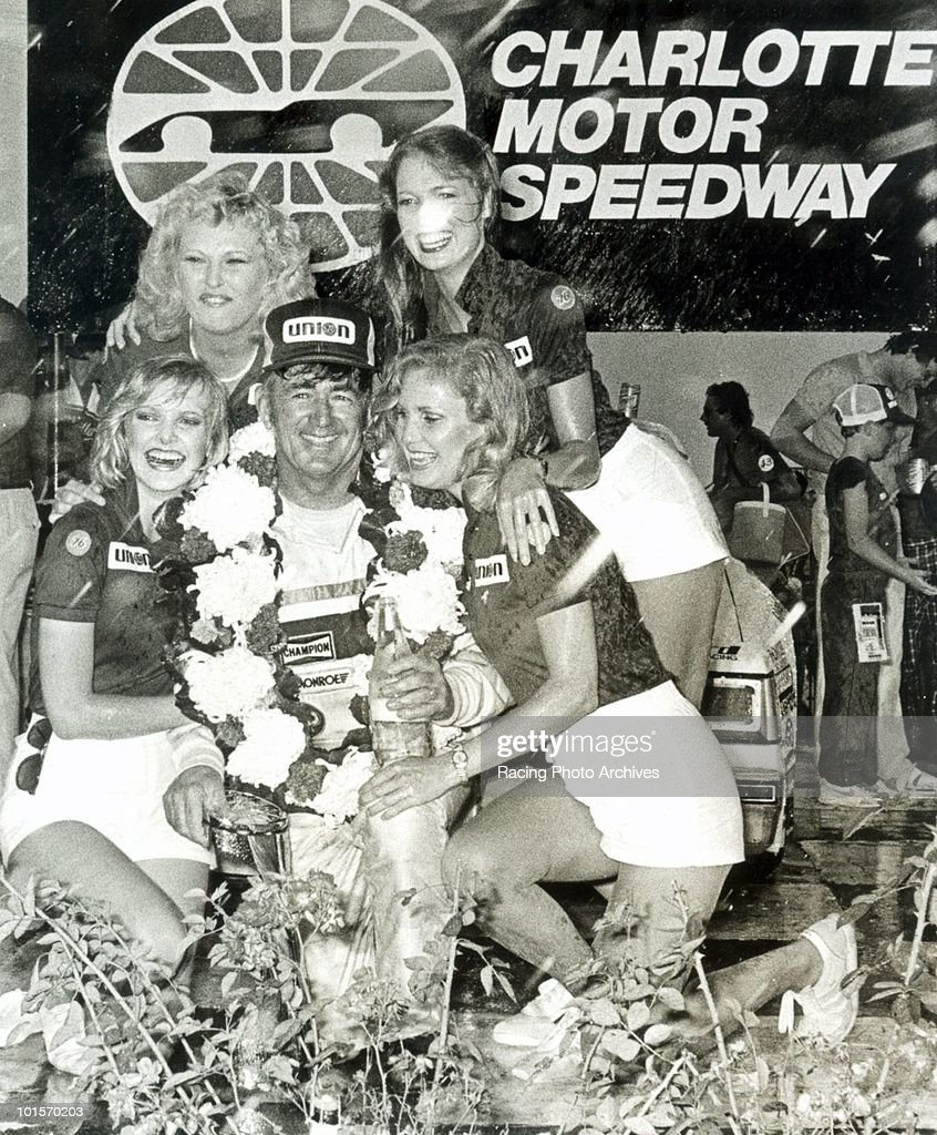 Bobby Allison celebrates in Victory Lane with the Winston girls. Allison would take home $88,500 for the World 600.