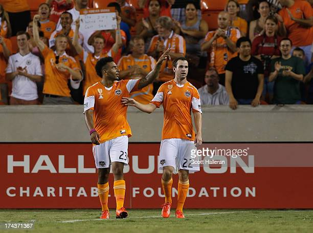 Bobby Boswell and Brian Ownby of the Houston Dynamo celebrate after Boswell scored a second half goal during the Dynamo Charities Cup at BBVA Compass...