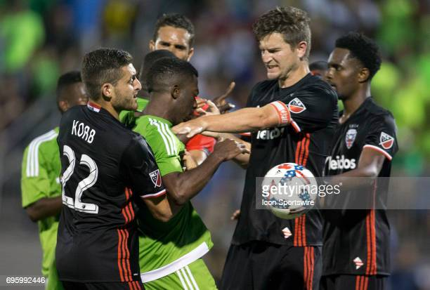 Bobby Boswell and Chris Korb of DC United in conflict with Levi Hauapeu of Christos FC after a hard tackle on Travis Worra during a US Open Cup match...