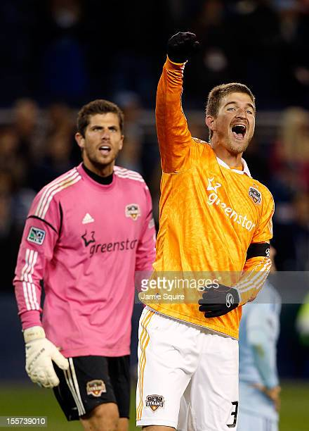 Bobby Boswell and goalkeeper Tally Hall of Houston Dynamo celebrate after the Dynamo advanced to the next round of playoffs during the Eastern...