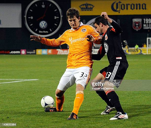 Bobby Boswell of the Houston Dynamo and Chris Pontius of the DC United battle for the ball at RFK Stadium on April 28 2012 in Washington DC