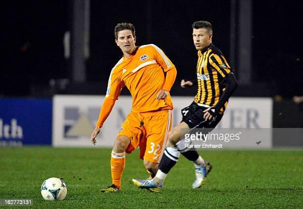 Bobby Boswell of the Houston Dynamo and Nicki Paterson of the Charleston Battery battle for the ball during the first half of the Carolina Challenge...