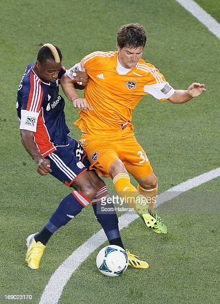 Bobby Boswell of the Houston Dynamo battles for a ball against Dimitry Imbongo of the New England Revolution in the first half at BBVA Compass...