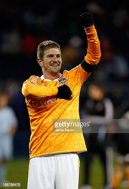 Bobby Boswell of the Houston Dynamo celebrates as the Dynamo lose the match 10 but advance to the next round of playoffs during the Eastern...