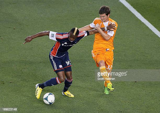Bobby Boswell of the Houston Dynamo chases a ball against Dimitry Imbongo of the New England Revolution in the first half at BBVA Compass Stadium on...