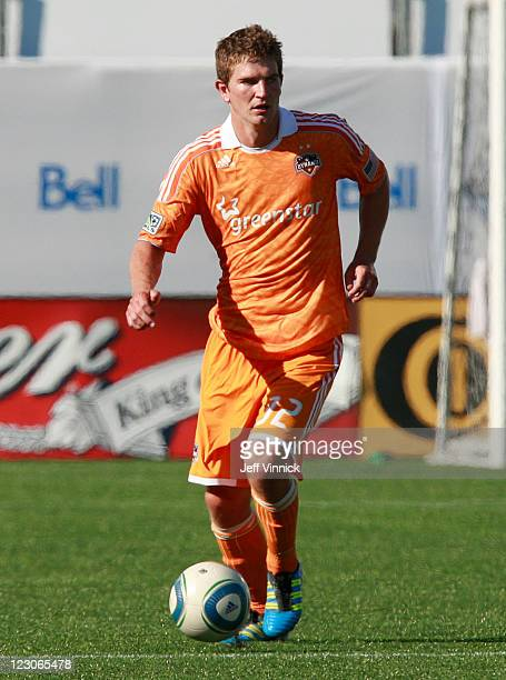 Bobby Boswell of the Houston Dynamo dribbles the ball upfield during their MLS game against the Vancouver Whitecaps FC August 27 2011 at Empire Field...