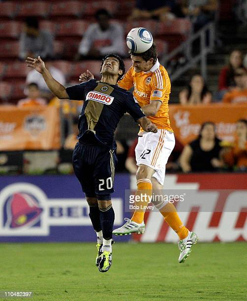 Bobby Boswell of the Houston Dynamo heads the ball away from Carlos Ruiz of the Philadelphia Union in the first half at Robertson Stadium on March 19...