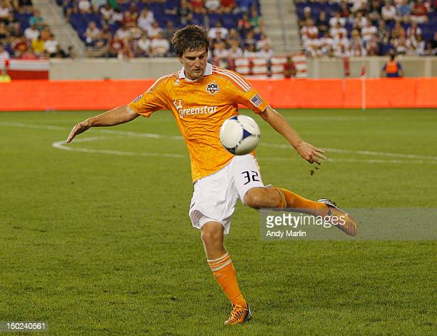 Bobby Boswell of the Houston Dynamo plays the ball against the New York Red Bulls during the match at Red Bull Arena on August 10 2012 in Harrison...