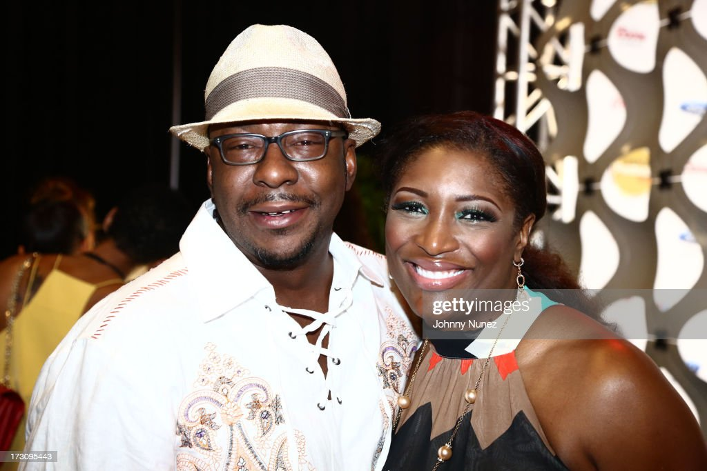 Bobby Brown and Tamara Johnson-George attend the 2013 Essence Festival at the Mercedes-Benz Superdome on July 6, 2013 in New Orleans, Louisiana.