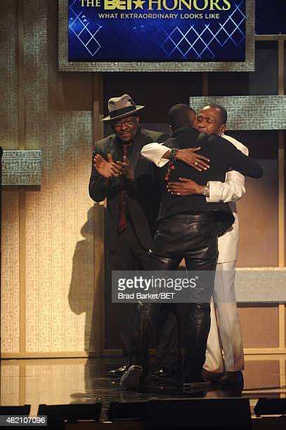 Bobby Brown Usher and Ben Vereen embrace onstage during 'The BET Honors' 2015 at Warner Theatre on January 24 2015 in Washington DC