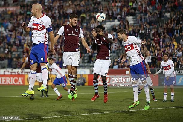 Bobby Burling of Colorado Rapids heads a corner kick on goal against Michael Bradley and Drew Moor of Toronto FC as Dominique Badji of Colorado...