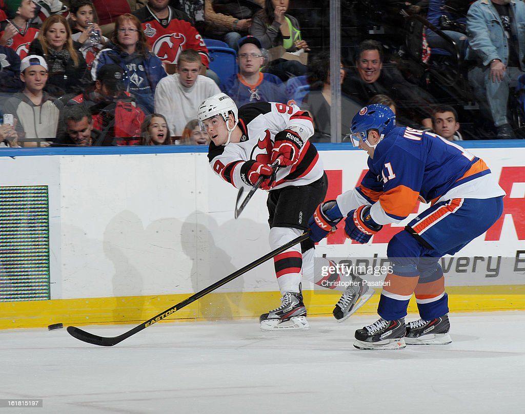 Bobby Butler #9 of the New Jersey Devils takes a shot on goal past Lubomir Visnovsky #11 of the New York Islanders during the game on February 16, 2013 at Nassau Veterans Memorial Coliseum in Uniondale, New York.