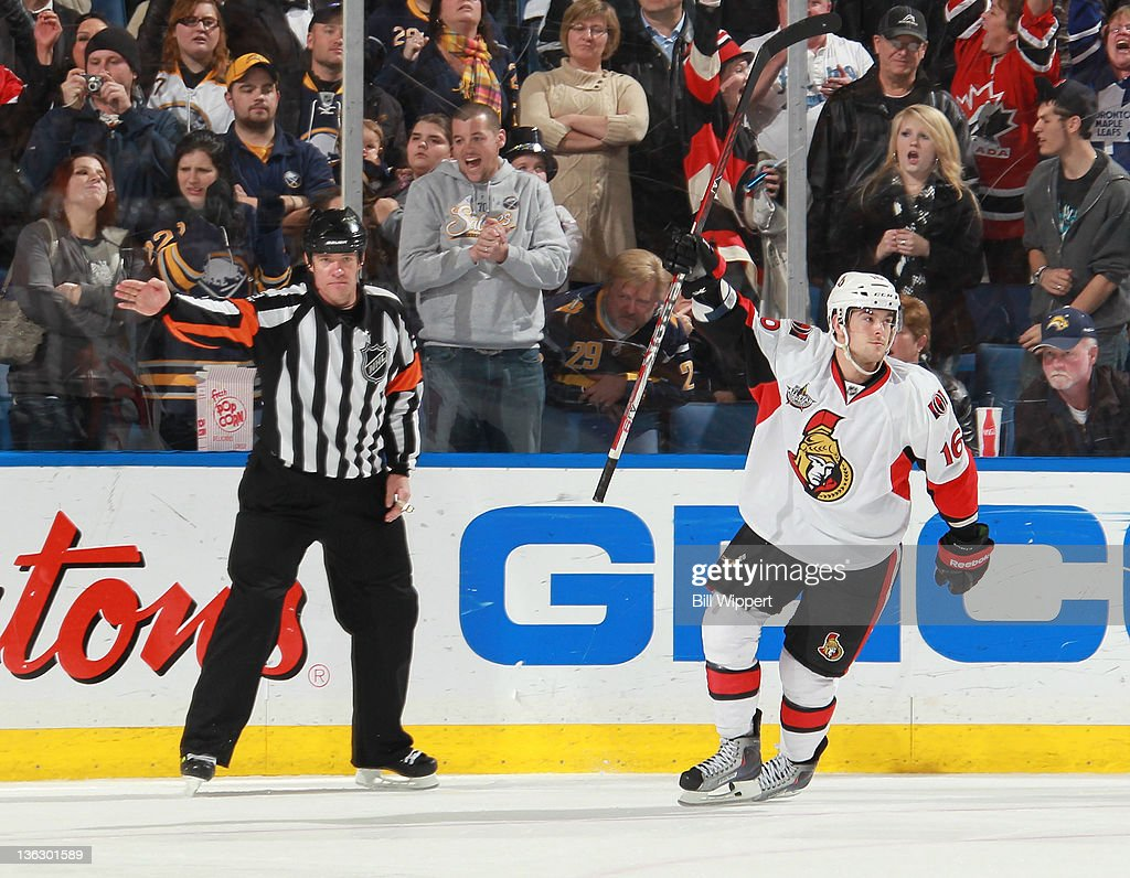Bobby Butler #16 of the Ottawa Senators celebrates after scoring the game-winning shootout goal against the Buffalo Sabres at First Niagara Center on December 31, 2011 in Buffalo, New York. Referee Dave Jackson signals the goal.
