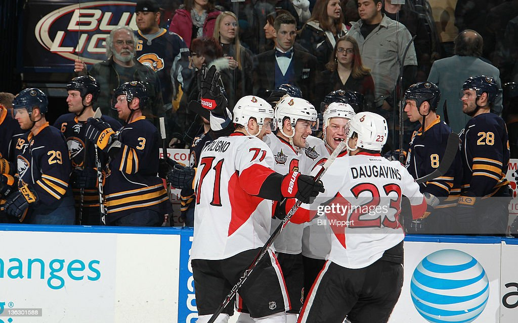 Bobby Butler #16 of the Ottawa Senators (2nd L) celebrates with teammates <a gi-track='captionPersonalityLinkClicked' href=/galleries/search?phrase=Nick+Foligno&family=editorial&specificpeople=537821 ng-click='$event.stopPropagation()'>Nick Foligno</a> #71, Chris Neil #25 and Kaspars Daugavins #23 after scoring the game-winning shootout goal against the Buffalo Sabres at First Niagara Center on December 31, 2011 in Buffalo, New York.