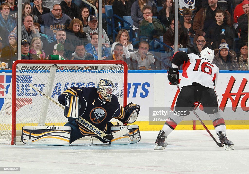 Bobby Butler #16 of the Ottawa Senators scores the game-winning shootout goal against <a gi-track='captionPersonalityLinkClicked' href=/galleries/search?phrase=Jhonas+Enroth&family=editorial&specificpeople=570456 ng-click='$event.stopPropagation()'>Jhonas Enroth</a> #1 of the Buffalo Sabres at First Niagara Center on December 31, 2011 in Buffalo, New York.