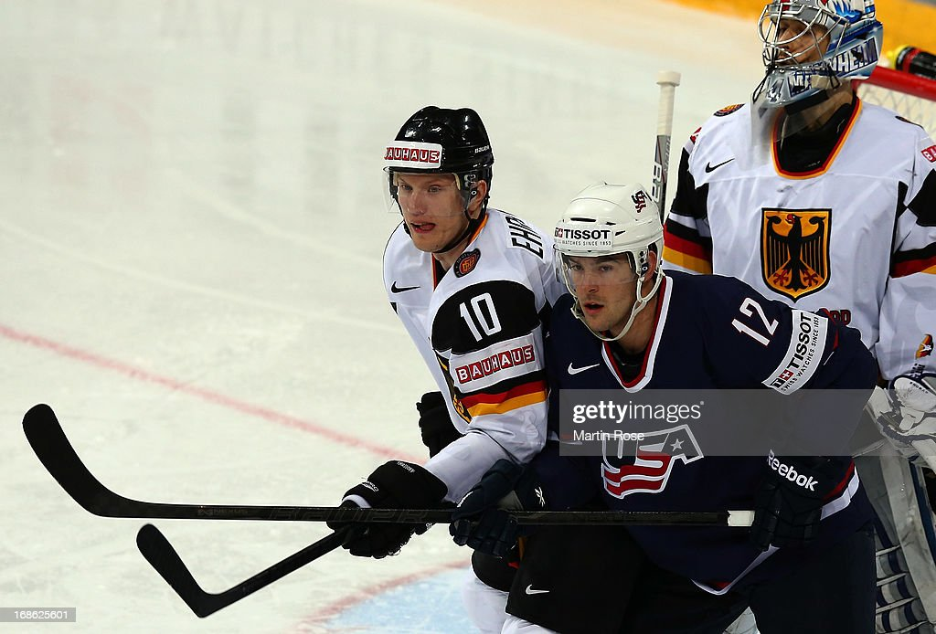 Bobby Butler of USA and Christian Ehrhoff of Germany battle for position in front of the net during the IIHF World Championship group H match between...
