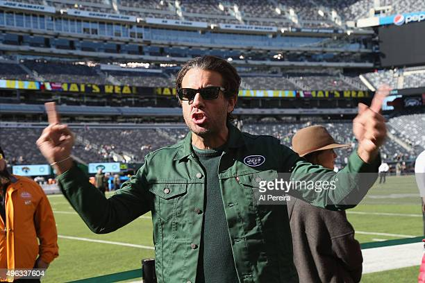 Bobby Cannavale works on his 'JETS' chant when he attends the New York Jets vs Jacksonville Jaguars game at MetLife Stadium on November 8 2015 in...