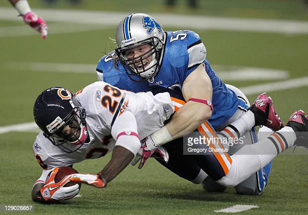 Bobby Carpenter of the Detroit Lions makes a tackle during a punt return on Devin Hester of the Chicago Bears at Ford Field on October 10 2011 in...