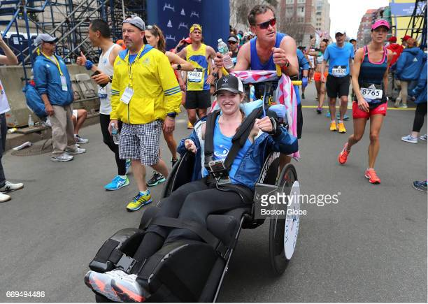 Bobby Carpenter pushes Denna Laing over the finish line of the 121st Boston Marathon on April 17 2017 Lang suffered a spinal injury playing hockey in...
