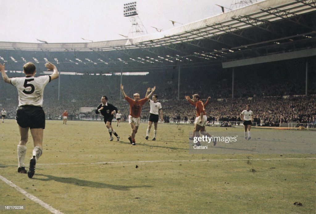 <a gi-track='captionPersonalityLinkClicked' href=/galleries/search?phrase=Bobby+Charlton&family=editorial&specificpeople=204207 ng-click='$event.stopPropagation()'>Bobby Charlton</a> (centre) holds his hands up as West German players protest after <a gi-track='captionPersonalityLinkClicked' href=/galleries/search?phrase=Geoff+Hurst&family=editorial&specificpeople=206880 ng-click='$event.stopPropagation()'>Geoff Hurst</a> scores the controversial third goal during the World Cup final at Wembley Stadium, London. The goal was given and England won the match 4-2, 30th July 1966.