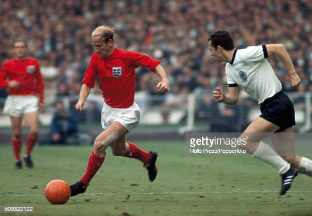 Bobby Charlton of England takes the ball past Franz Beckenbauer of West Germany during the World Cup Final at Wembley Stadium in London on 30th July...