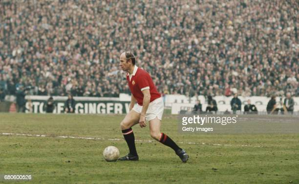 Bobby Charlton of Manchester United runs with the ball during the League Division One match between Chelsea and Manchester United held on April 28...
