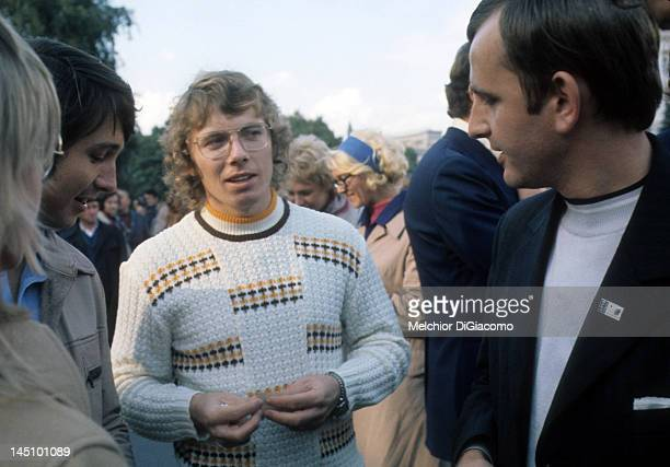 Bobby Clarke and Brad Park of Canada exchange pins with fans while touring Moscow between games against the Soviet Union during the 1972 Summit...