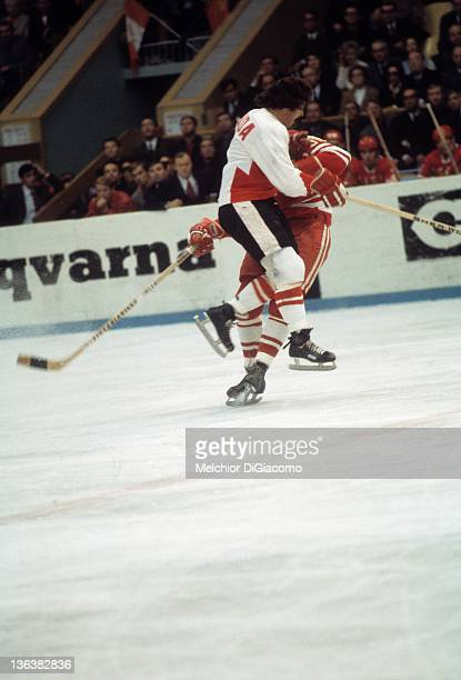 Bobby Clarke of Canada checks Alexander Volchkov of the Soviet Union during the 1972 Summit Series at the Luzhniki Ice Palace in Moscow Russia