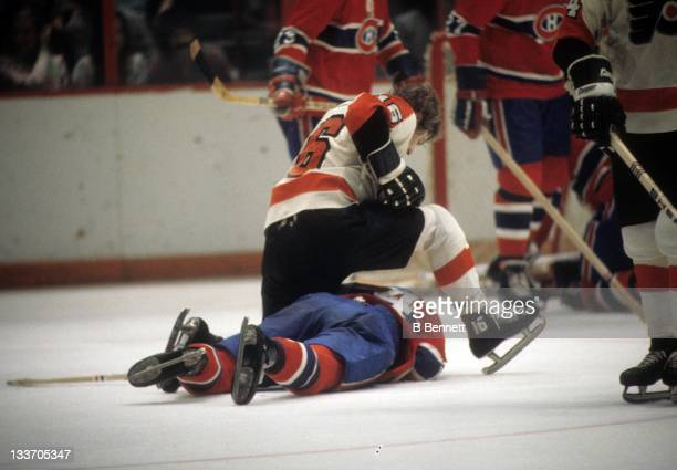 Bobby Clarke of the Philadelphia Flyers sits on Mario Tremblay of the Montreal Canadiens during their game circa 1975 at the Spectrum in Philadelphia...