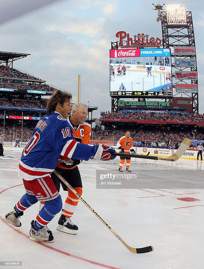<a gi-track='captionPersonalityLinkClicked' href=/galleries/search?phrase=Bobby+Clarke&family=editorial&specificpeople=213882 ng-click='$event.stopPropagation()'>Bobby Clarke</a> #16 of the Philadelphia Flyers skates against Ron Duguay #10 of the New York Rangers during the 2012 Bridgestone NHL Winter Classic Alumni Game on December 31, 2011 at Citizens Bank Park in Philadelphia, Pennsylvania.