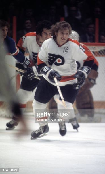Bobby Clarke of the Philadelphia Flyers skates on the ice during an NHL game against the New York Rangers circa 1975 at the Spectrum in Philadelphia...