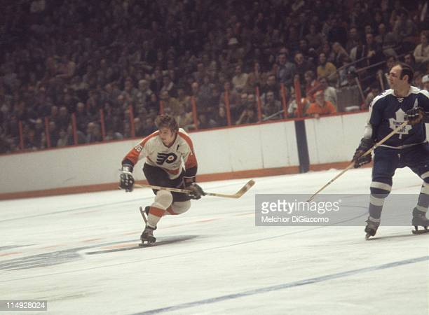 Bobby Clarke of the Philadelphia Flyers skates over the red line during an NHL game against the Toronto Maple Leafs on February 20 1972 at the...