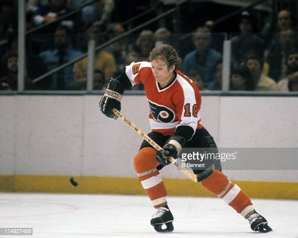 Bobby Clarke of the Philadelphia Flyers tries to knock down the puck during an NHL game circa 1978