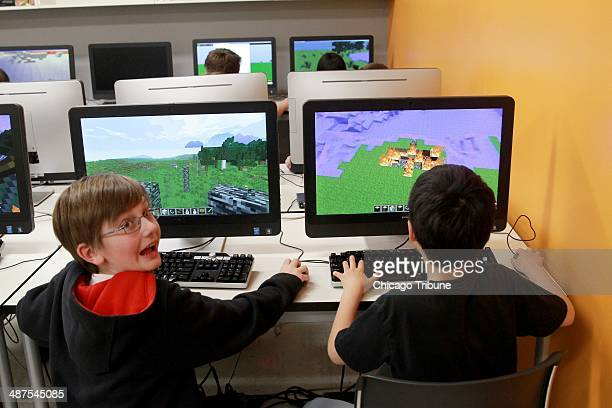 Bobby Craig left and Doogy Lee create worlds in Minecraft that parallel what they have bene reading in 'The Hobbit' as part of their fifth grade...