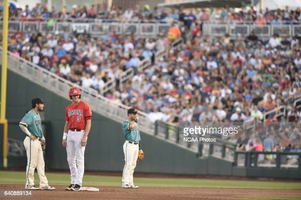 Bobby Dalbec of University of Arizona looks to his coach for a sign while on second base against Coastal Carolina University during the Division I...
