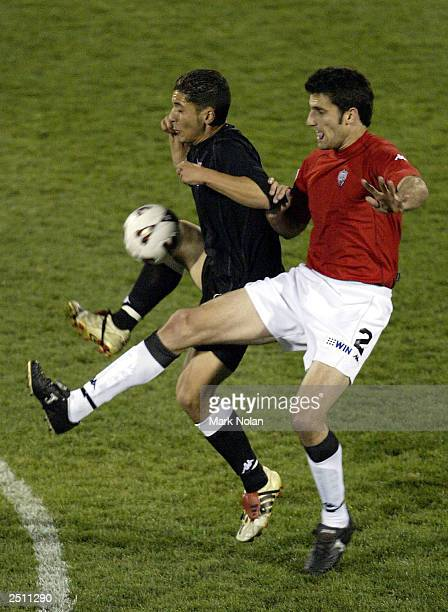 Bobby Dragas of the Wolves and Tolgay Ozbey of Sydney United compete for the ball during the opening round of the 2003 NSL season between the...