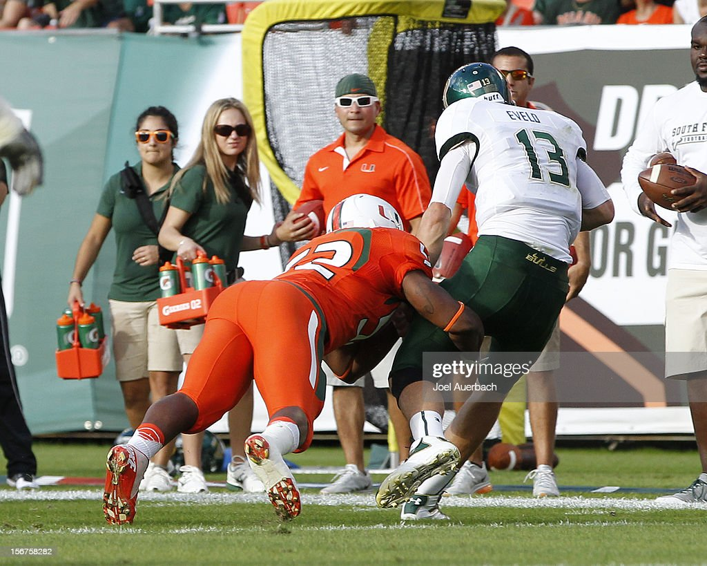Bobby Eveld #13 of the South Florida Bulls is injured after being tackled by Denzel Perryman #52 of the Miami Hurricanes on November 17, 2012 at Sun Life Stadium in Miami Gardens, Florida. The Hurricanes defeated the Bulls 40-9.
