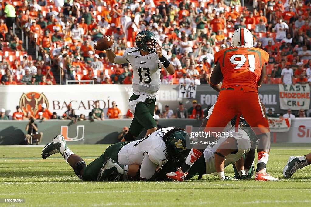 Bobby Eveld #13 of the South Florida Bulls throws the ball against the Miami Hurricanes on November 17, 2012 at Sun Life Stadium in Miami Gardens, Florida. The Hurricanes defeated the Bulls 40-9.