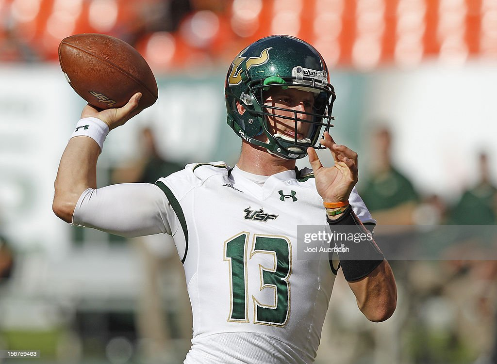 Bobby Eveld #13 of the South Florida Bulls throws the ball prior to the game against the Miami Hurricanes on November 17, 2012 at Sun Life Stadium in Miami Gardens, Florida. The Hurricanes defeated the Bulls 40-9.