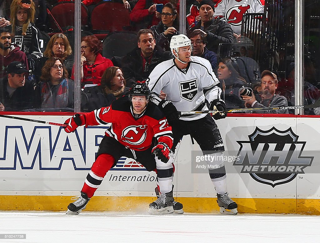 Bobby Farnham #23 of the New Jersey Devils and Brayden McNabb #3 of the Los Angeles Kings battle for position during the game at the Prudential Center on February 14, 2016 in Newark, New Jersey.
